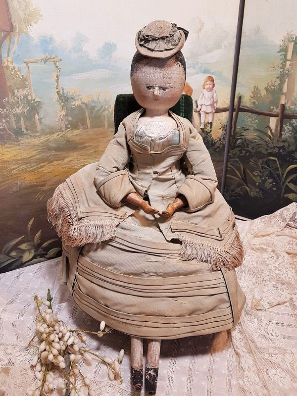 Outstanding Early Wooden Doll with Fantastic Silk Costume