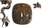 Japanese metal Tsuba with snake and bird made by Iwamoto Konkan