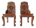 Pair of Chinese Hardwood Chairs with Detailed Carvings