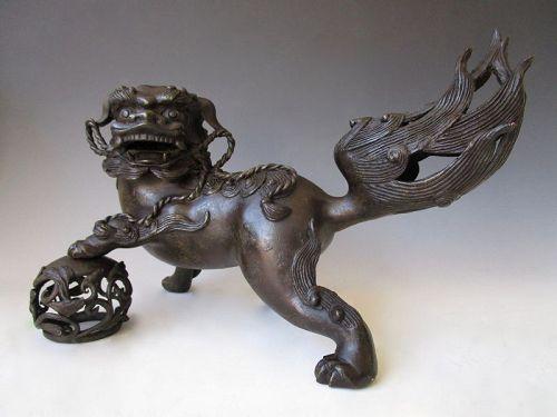 Vintage Japanese Bronze Shishi Fu Dog Holding Scrolling Vine Sphere